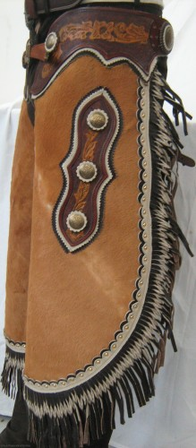 Chinks made from calf-hair with hand beaten leather accents and cochos